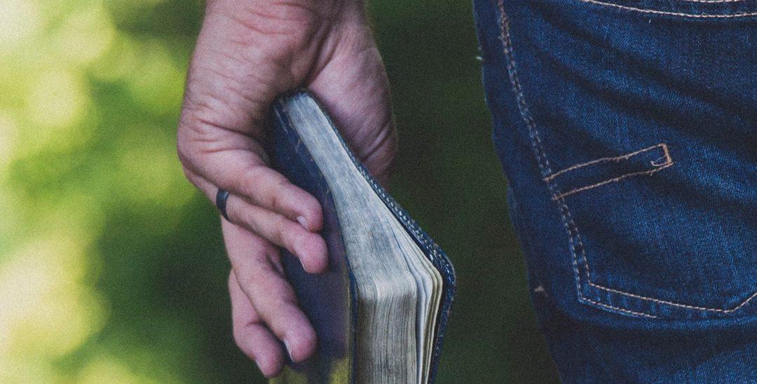 Guy holding Bible