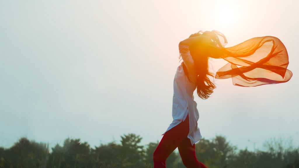 Woman-Walking-in-Wind