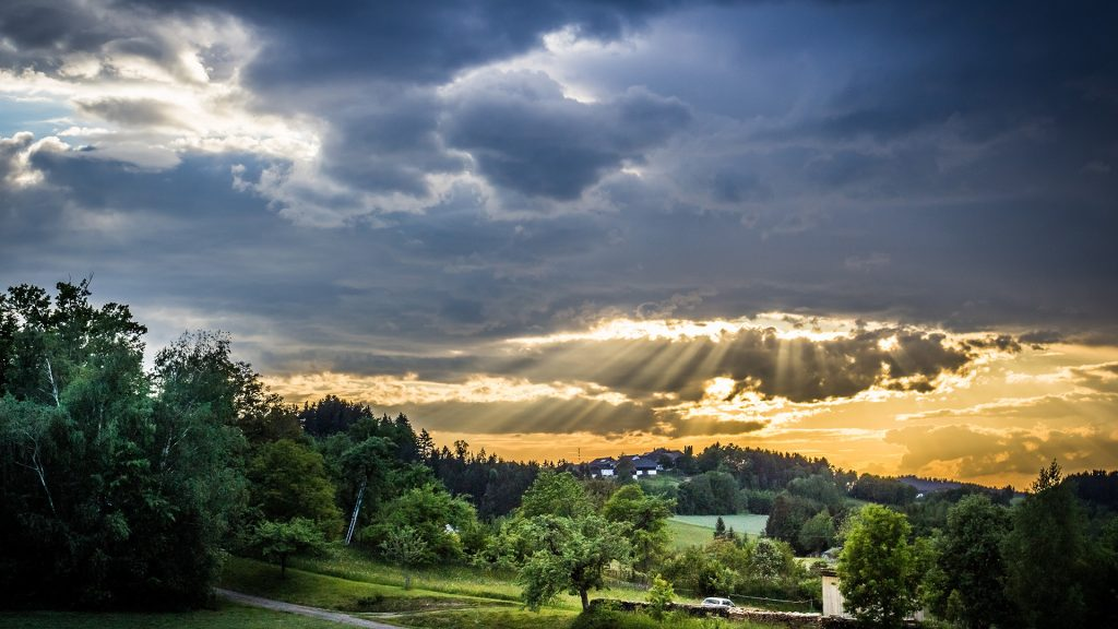 sunrays-behind-the-clouds