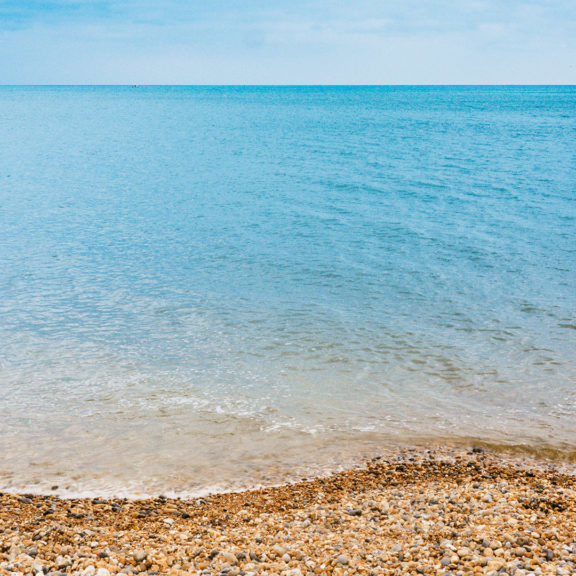 blue-body-of-water-under-blue-sky-photography